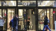 Shoppers enter the Mall Of Berlin in Berlin Germany on Tuesday November 25 gvs of the sign above the doors wide shot of shoppers walking through the...