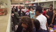 Shoppers grab supplies including water at the HEB Grocery store in Houston Texas US on Thursday Aug 24 2017 Hurricane Harvey set to make landfall on...