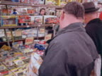 Shoppers look at toys in a department store