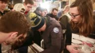 Shoppers look for rare new and rereleased recordings on vinyl and CD during the 10th anniversary Record Store Day at Landlocked Music in Bloomington...