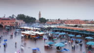 Shoppers move about the Djemaa el-Fna market on a rainy day in Marrakesh.