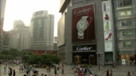 Shoppers pass the Cartier store in a Japanese shopping district. Available in HD.