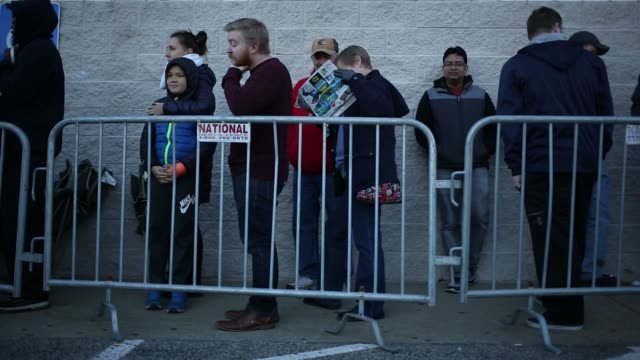 Shoppers wait outside at a Best Buy Co store before opening on black Friday in Louisville Kentucky US on Thursday Nov 23 2017 Photographer Luke...