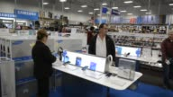 Shoppers wait to purchase television sets at a Best Buy Co store ahead of Black Friday in San Francisco California US Customers pick up electronics...