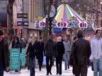 Shoppers walk along St Marys Street in Cardiff.