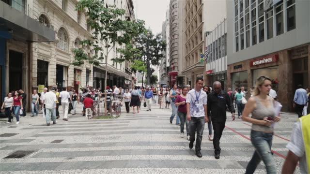 Ws Shoppers Walk Through A Busy Street In Downtown Sao ...