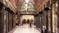 Shoppers walk through the Cross Arcade on King Edward Street in Leeds. Available in HD.