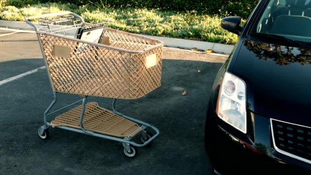 Shopping cart slams into car