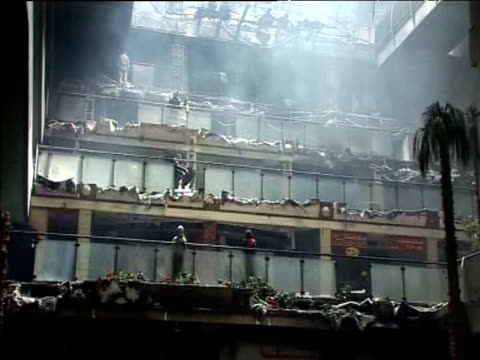 A shopping centre looted and burnt during an antigovernment demonstration Cairo