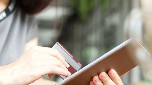 Shopping woman holding a Smartphone and Credit card