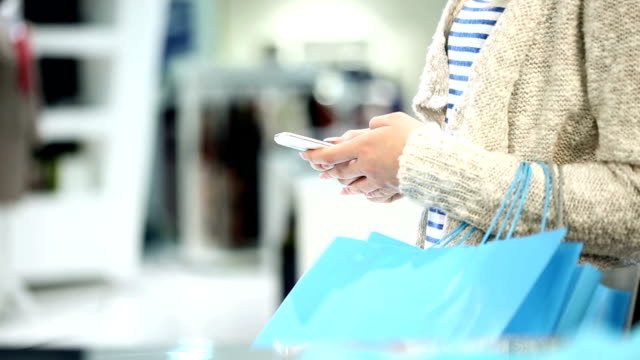 Shopping woman using a Smartphone