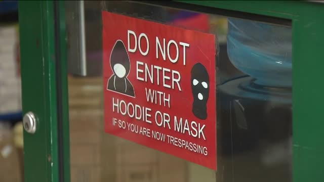 Shops and restaurants in Harlem have posted warning signs They read 'do not enter with hoodie or mask If so you are now trespassing' Storeowners say...