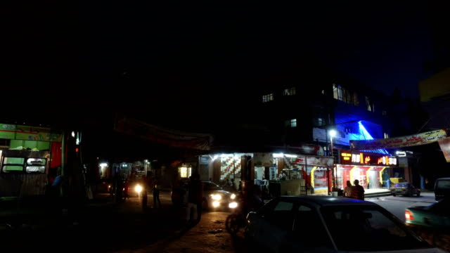 Shops are seen lit up at night on July 21 2017 in Gaza City Gaza For the past ten years Gaza residents have lived with constant power shortages in...
