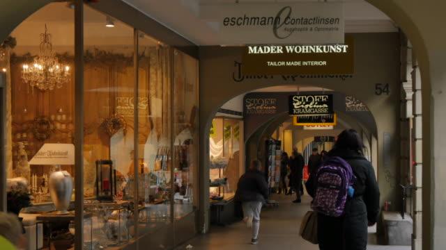 Shops in arcade on Marktgasse, Bern, Canton of Bern, Bernese Oberland, Swiss Alps, Switzerland, Europe