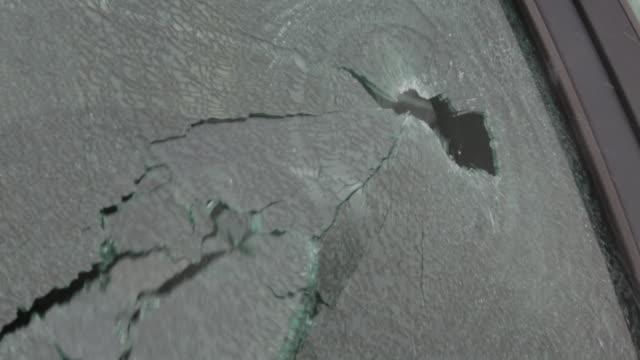 Shot fired through car window