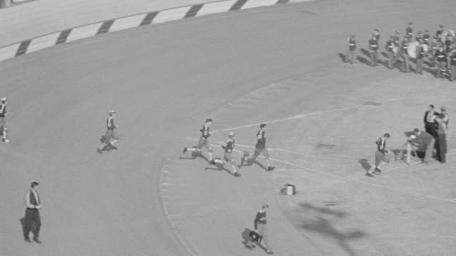 MS TS PAN Shot football players entering on field