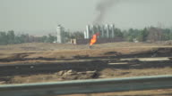 POV shot from a car of oil fields in northern Iraq NNBZ123B ABSA627D