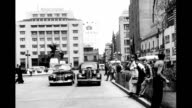 Shot from automobile reverse angle showing street receding central district downtown Downtown street scenes on January 01 1940 in Mexico City Mexico