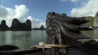 POV shot from the prow of a boat as it travels across Ha Long Bay, Vietnam.