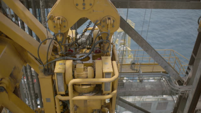 MS SLO MO Shot from top of oil rig in to machinery / The North Sea
