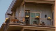 Shot looking up at an apartment balcony.