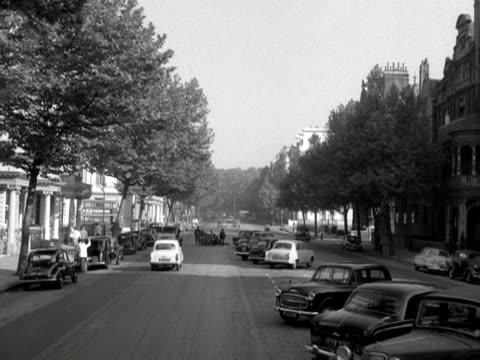 POV shot moving along an elegant avenue in the Kensington area of London
