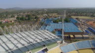 WS AERIAL Shot moving over stadium and nearby building / North West Province, South Africa