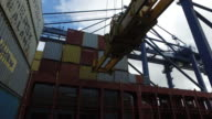 Shot of a crane picking up a transport container from the deck of a container ship at the port of Felixstowe