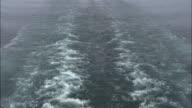 Shot of a passenger ferries wake as it travels along the Norwegian coastline.