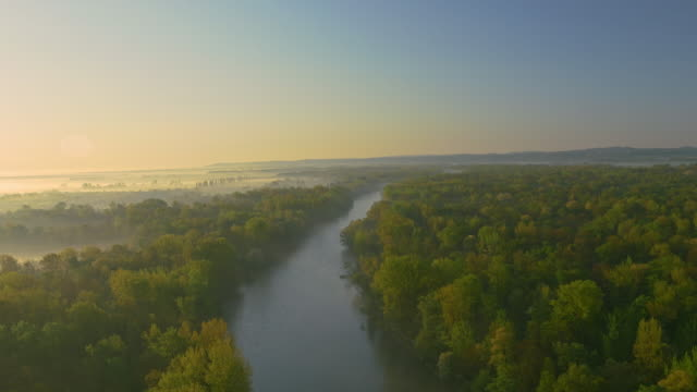 AERIAL shot of a river at dawn