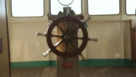 Shot of a ships wheel spinning.