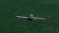 AERIAL HD shot of a tractor spraying a plowed field, Israel