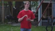 Shot of a young man doing sign language