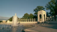 WS PAN shot of across World War II Memorial pillars and water fountains / Washington, District of Columbia, United States