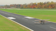 WS TS AERIAL Shot of airplane on runway and launches at Wright B Flyer / Dayton, Ohio, United States