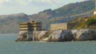 MS DS AERIAL Shot of Alcatraz Island and prison complex / San Francisco, California, United States