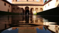 MS LA Shot of Alcazar palace with water in city / Sevilla, Andalusia, Spain