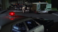 MS Shot of ambulance driver loading body into ambulance and drives out