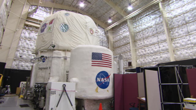 WS PAN Shot of American flag hanging on wall to Deep Space Habitat Module at NASA Johnson Space Center / Houston, Texas, United States