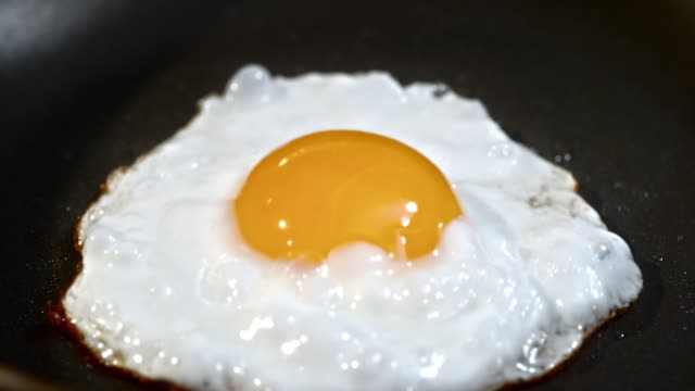 TD shot of an egg frying in the skillet