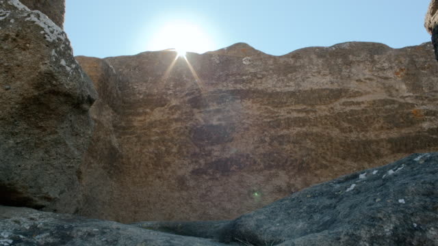 CU LA TU Shot of Ancient rock church rests of Bobastro with sun flare / Ardales, Malaga, Spain