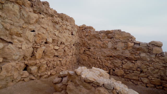 MS PAN Shot of ancient ruins at Masada in Negev desert to ruins Dead Sea / Israel