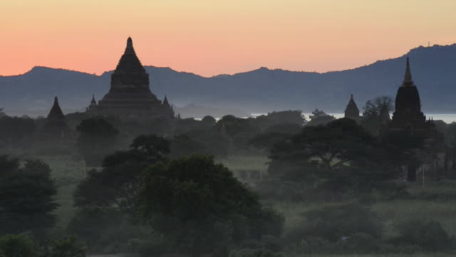 WS Shot of Ancient temples at Pagodas field at dusk / Bagan, Mandalay Division, Myanmar