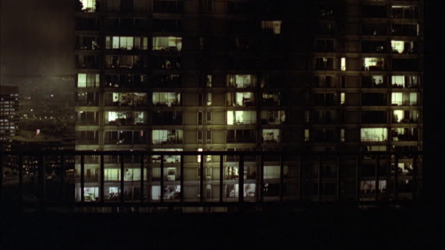 CU TU TD Shot of apartment building with balconies at night