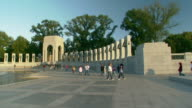 MS POV Shot of approach World War II Memorial with tourists walking / Washington, District of Columbia, United States
