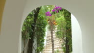MS TU Shot of  archway framing waterfall and beautiful garden at boutique hotel resort / Playa del Carmen, Quintana Roo, Mexico