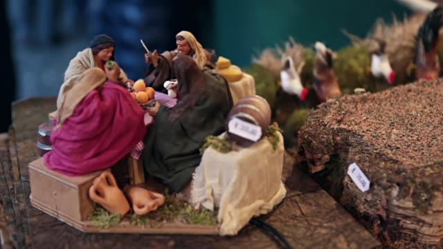 CU Shot of artisan made presepio figurines for nativity scenes in historical Christmas Market of Piazza Novena / Rome, Italy