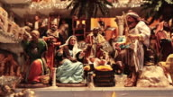 MS Shot of artisan made presepio figurines for nativity scenes in historical Christmas Market of Piazza Novena / Rome, Italy