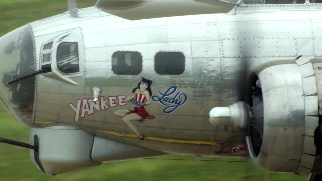 CU AERIAL Shot of B17 Bomber with Yankee Lady sign on side of his aircraft at Willow Run Airport / Ypslanti, Michigan, United States