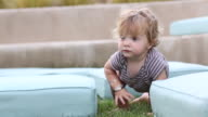 MS Shot of baby boy crawling around outside / Santa Fe, New Mexico, United States